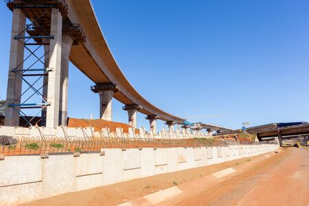 flyovers: Construction new traffic road highway intersection junction flyover ramps of concrete steel design.