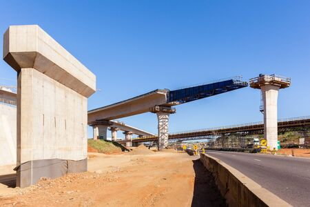Construction new traffic road highway intersection junction flyover ramps of concrete steel design.
