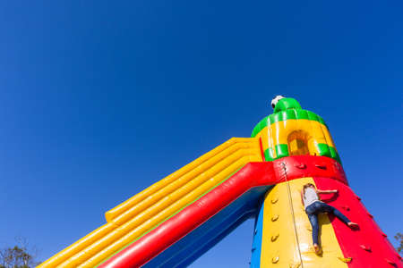 playtime: Playground inflatable castle for children entertainment. Stock Photo