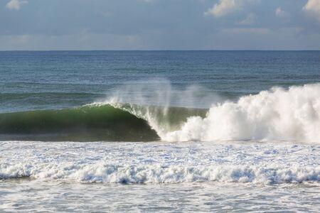 crashing: Ocean Waves crashing water power along beach rocky coastline from storm weather. Stock Photo