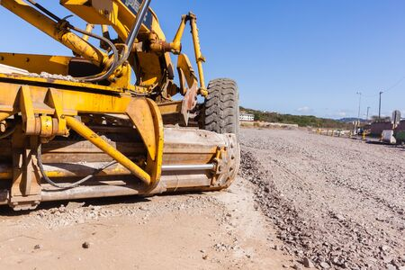 Grader industrial machine on construction of new roads. Stock Photo