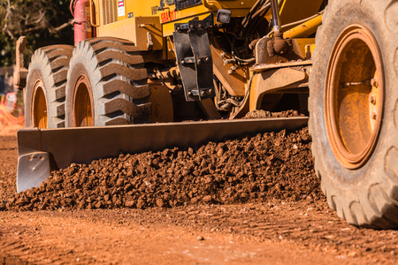 grader: Grader industrial machine on construction of new roads. Stock Photo