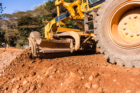 hydraulics: Grader industrial machine on construction of new roads. Stock Photo