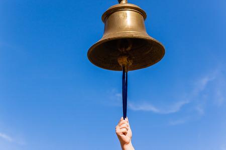 ringing: Brass bell closeup ringing sound notice instrument..