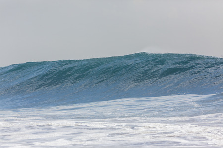swells: Ocean wave swell crashing water power towards beach from weather storms.
