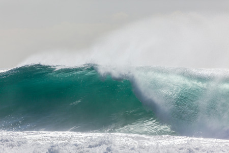 crashing: Ocean waves crashing water power towards beach from weather storms. Stock Photo