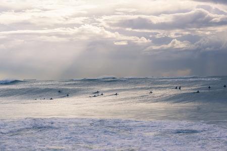 ocean waves: Surfers surfing ocean storm large waves