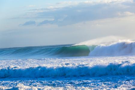 waves crashing: Ocean waves crashing water power towards beach from weather storms. Stock Photo