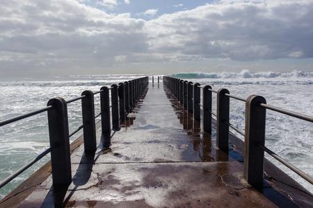 crashing: Beach pier storm waves crashing power of nature
