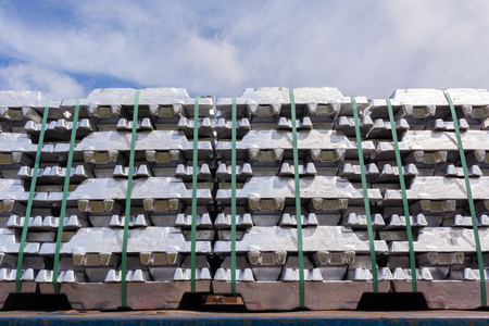 ingots: Aluminum ingots industrial metals stacked on transport trailer from refinery to factory products. Stock Photo
