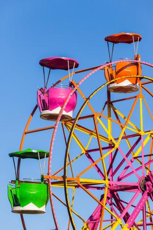 rotational: Ferris wheel cabin gondolas closeup three rotating pods for patrons enterainment