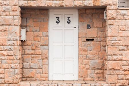thirty five: Roadside door entrance number thirty five tiled decor walls.