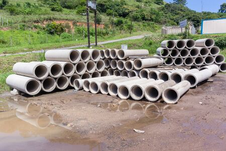 dozens: Concrete pipes stacked factory products for infrastructure construction.