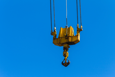 lifting hook: Crane arm  lifting machine with cables dual pulleys to hoist hook. Stock Photo