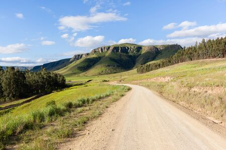 Rural dirt road along scenic mountain landscape Stock Photo
