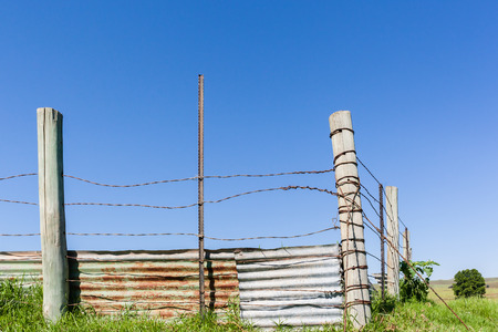 Farm rural fence wire poles cattle pen corral structure. Stock Photo