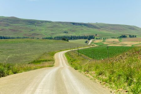 Dirt road route through mountain farming landscape