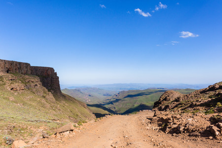 dirtroad: Mountains valley river overlooking horizon landscape Sani-Pass Drakensberg South-Africa. Stock Photo