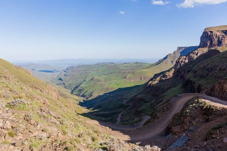 dirtroad: Mountain dirt road up sani-pass rugged route scenic rural mountain valley landscape