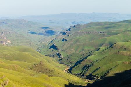 dirtroad: Mountains valley river horizon birds eye  landscape Sani-Pass Drakensberg South-Africa.