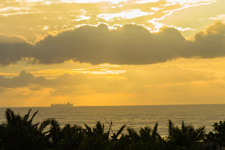 seas: Ships silhouetted  crossing on ocean seas dawn morning landscape Stock Photo