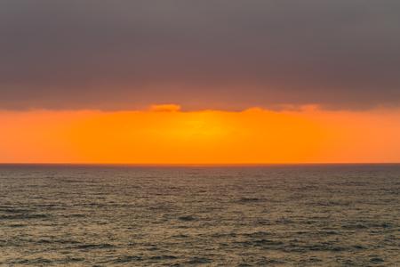 seas: Ocean horizon clouds sunrise rays colors contrasted seas landscape Stock Photo