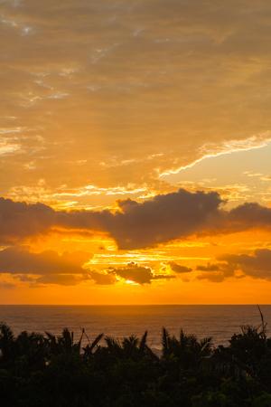 Ocean horizon clouds sunrise rays colors contrasted seas coastline landscape Stock Photo