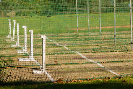 Cricket practice nets wickets pitch for batting bowling.