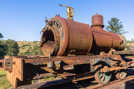 Steam Train old vintage steam locomotives boiler stamped 1951 decaying station graveyard. Stock Photo