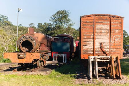 Trains old vintage steam locomotives boilers coaches decaying station graveyard.