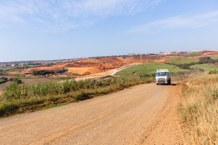 Industrial construction expansion into countryside sugarcane fields expanding earthworks infrastructure. Stock Photo