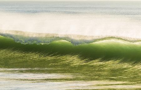 Wave crashing curling closeup ocean beach Stock Photo - 78534631
