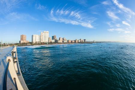 stadium  durban: Durban pier morning scenic photo of beach ocean surfing landscape Stock Photo