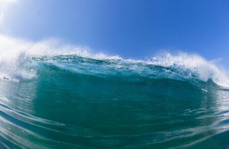 Wave crashing closeup swimming blue water ocean photo Stock Photo