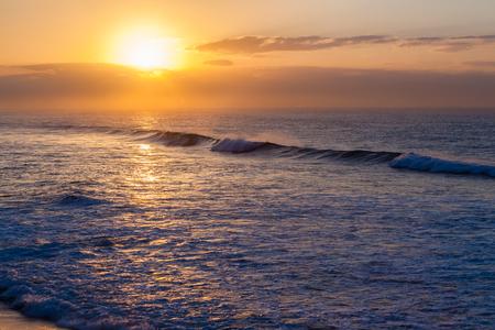 Ocean waves crashing beach horizon dawn sunrise landscape