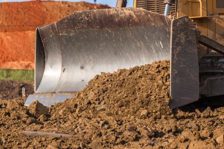 Construction industrial earthworks dozer bucket closeup sand stones c abstract.
