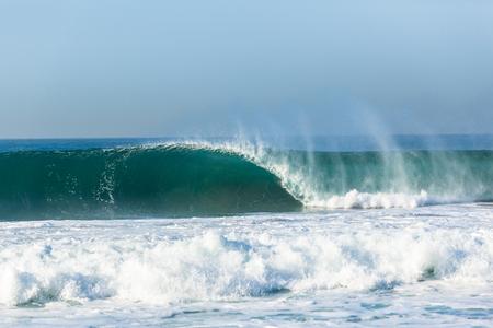 Wave hollow curling crashing ocean water power .