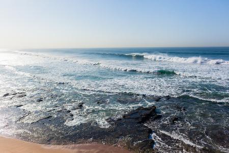 Waves overlooking swells crashing ocean water power horizon landscape.