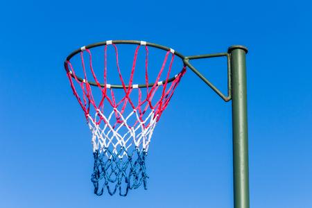 Netball net hoop pole outdoors court venue.