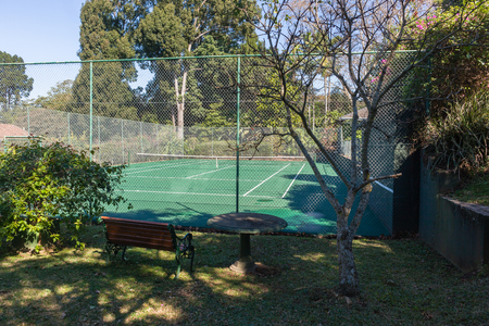 Tennis court green hard surface private secludedgarden landscape.