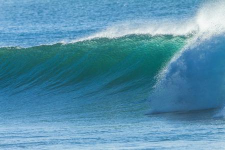 Ocean wave wall curling closeup crashing water Stock Photo