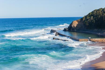 Thompsons Bay beach ocean waves tidal swimming pool coastline landscape. Stock Photo