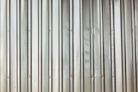 Metal galvanized ibr sheeting contruction material closeup texture background.