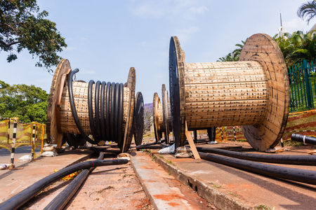 Construction Electrical new high voltage power cables wood drums  been installed in underground Trenches.