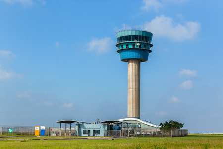 Airport Air traffic control tower for planes in countryside landscape.
