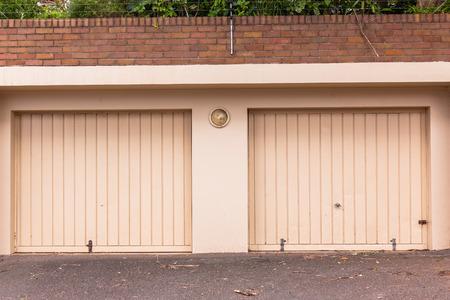 Double Garage Doors Beige Cream Colors Road Entrance For Vehicles. Stock  Photo   88080032