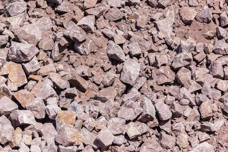Industrial earthworks blasting rocks spread closeup textures background overhead photo. 版權商用圖片 - 88341598