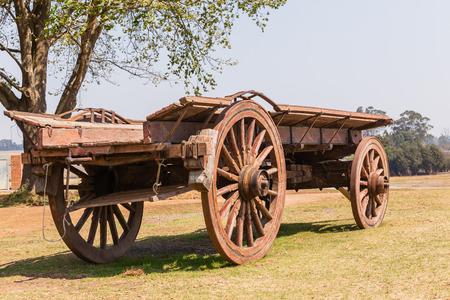 Settlers wood ox wagon closeup of vintage ancient travel  vehicles Foto de archivo