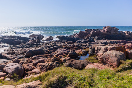 Rocky coastline summer ocean waves landscape photo tones Stock Photo