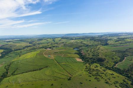 Aerial view farmlands crop valley landscape summer green photo.